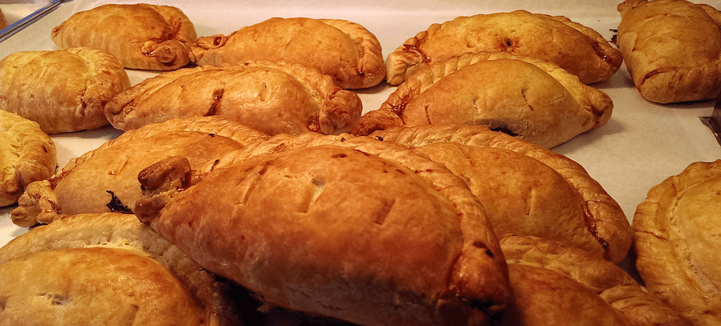 Freshly baked Cornish pasties on the Plymouth Barbican England